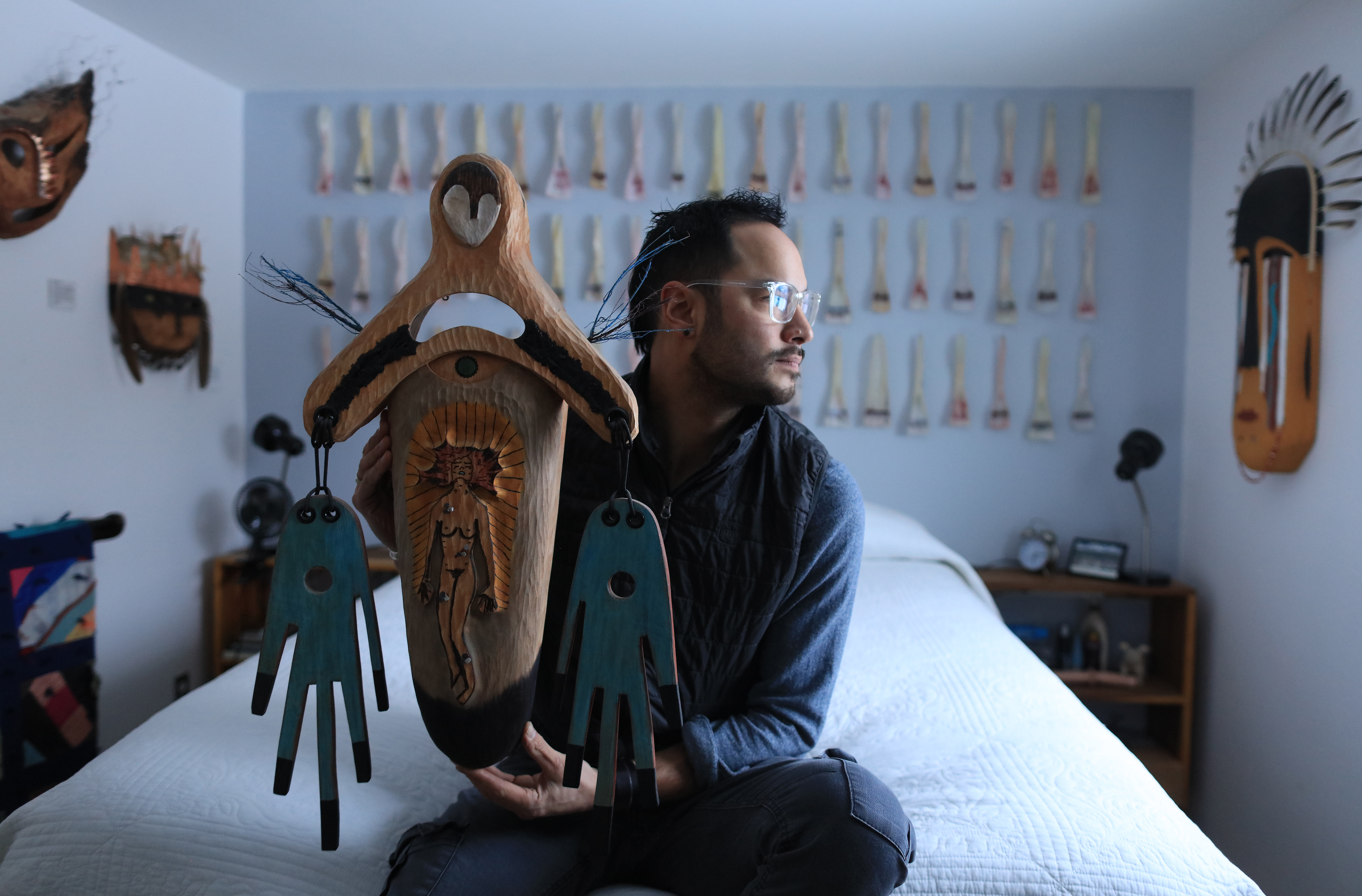 Drew Michael holding 'Salvation of a Lost Soul' in his Anchorage home